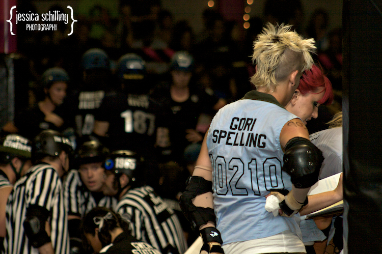 punk rock roller derby team preparing during a time out