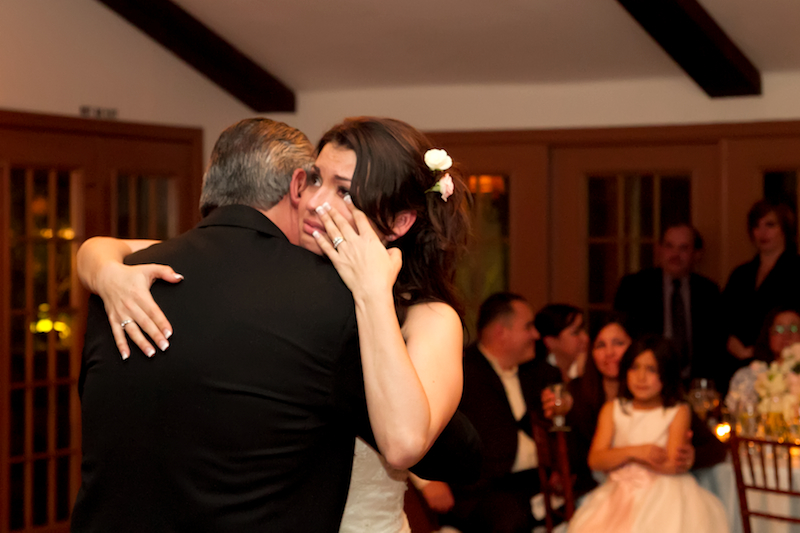 Emotional photojournalist photography of bride crying during father daughter dance at Rancho Las Lomas wedding reception