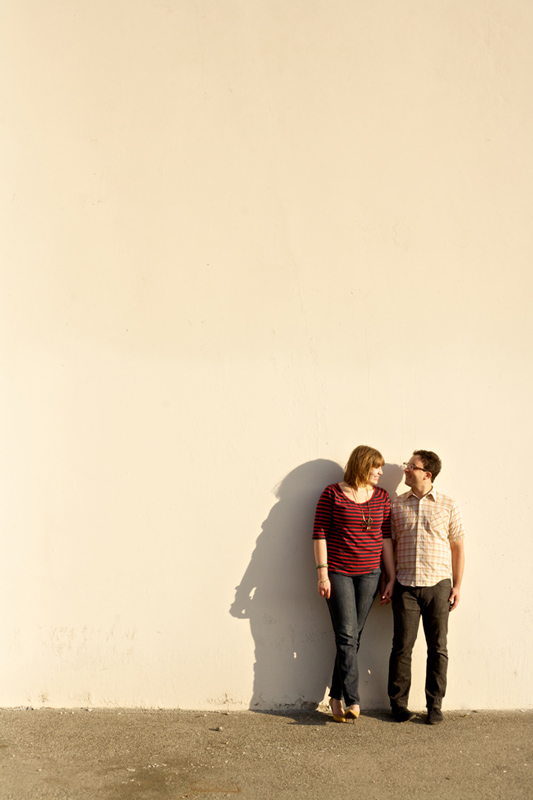 Modern hip cool Los Angeles engagement photography with indie couple against blank wall