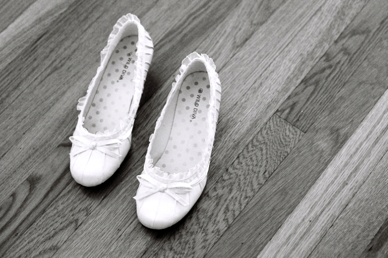 Wedding details of cool indie shoes on 35mm black and white film