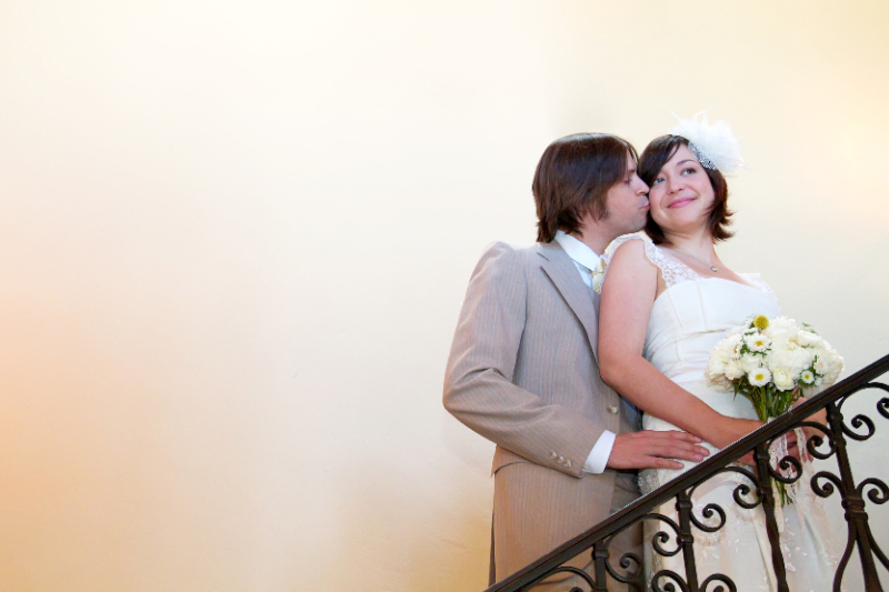 Indie bride and groom portrait on staircase