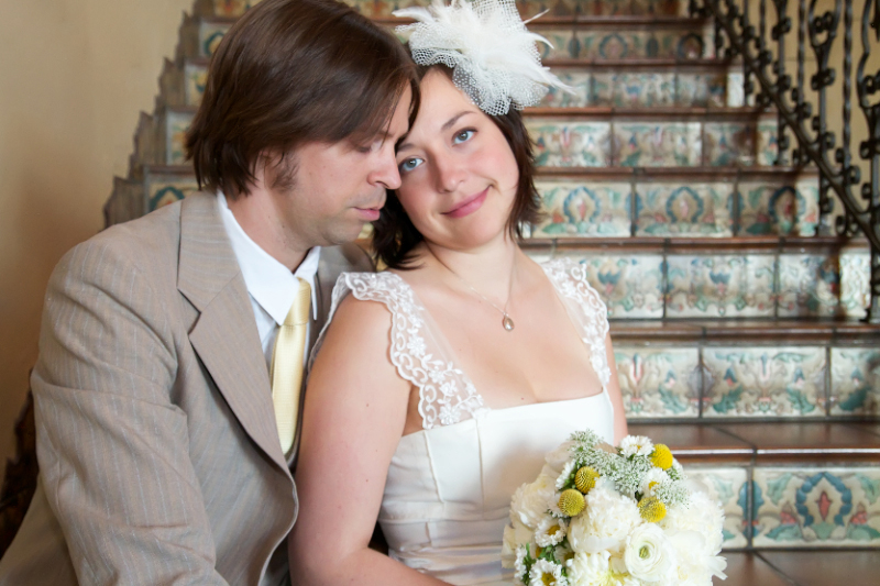Dreamy romantic bohemian couple on Spanish tiled staircase for bride and groom portraits