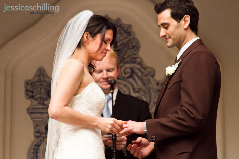 Beautiful bride and groom exchange rings during ceremony at Rancho Las Lomas wedding