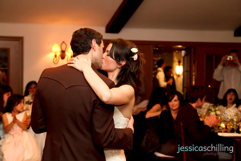Bride and groom sweet romantic sexy kiss while dancing at wedding reception