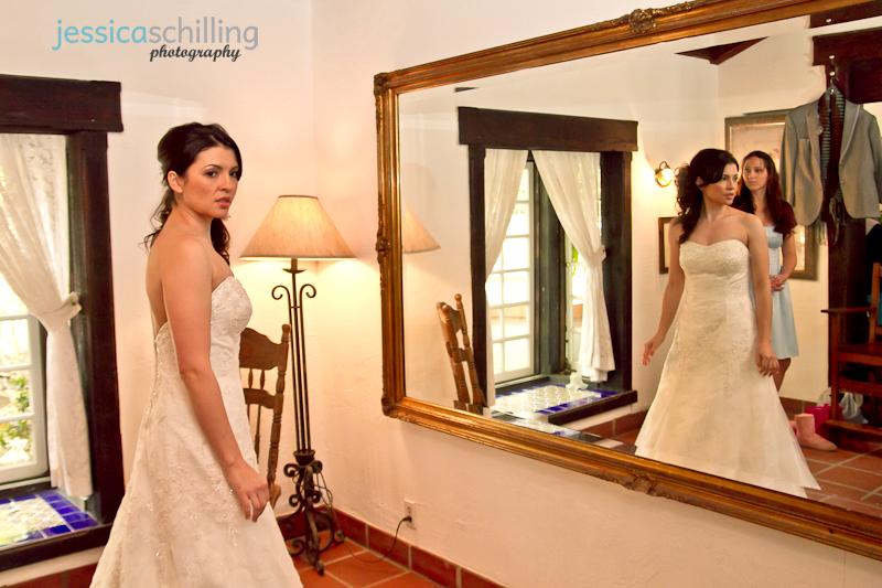 Rancho Las Lomas bridal room wedding photography of bride looking in mirror