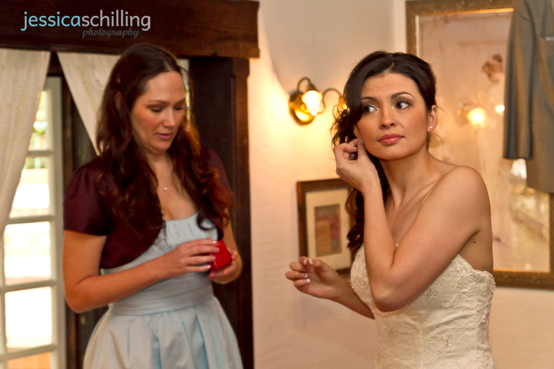 Documentary wedding photographer captures bride getting ready with earrings and jewelry