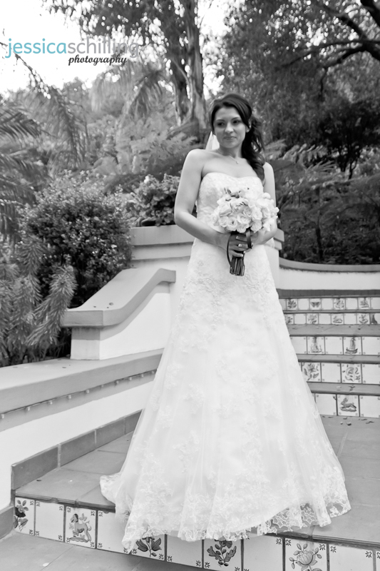 Beautiful classic artistic bridal portrait of stunning bride Erica in wedding gown with bouquet