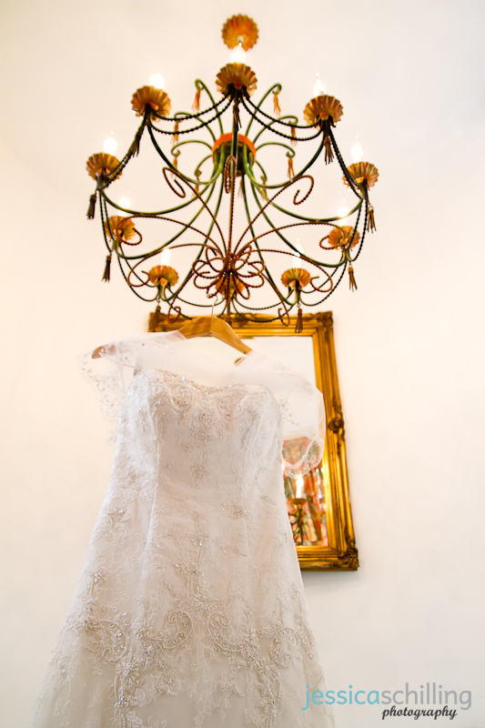 Indie wedding photography cool modern details of dress hanging from chandelier