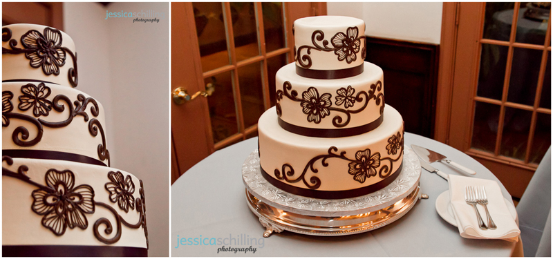 Modern artistic indie wedding cake of brown scrolls and flowers on blue tablecloth