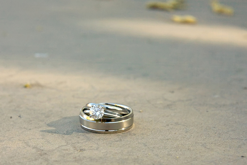 detail shot of wedding bands and diamond engagement ring by Los Angeles indie wedding photographer Jessica Schilling