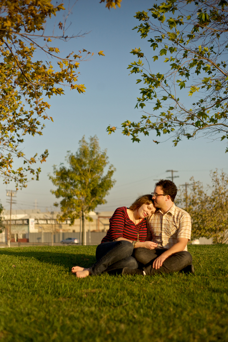 Modern hip engagement photo of couple in field with leaves changing in autumn Los Angeles