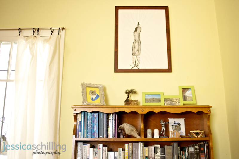 Awesome indie bookshelf in cool living room with books, art, trinkets
