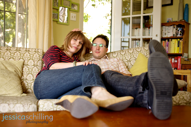 Cute indie couple in mid century modern living room for engagement photography