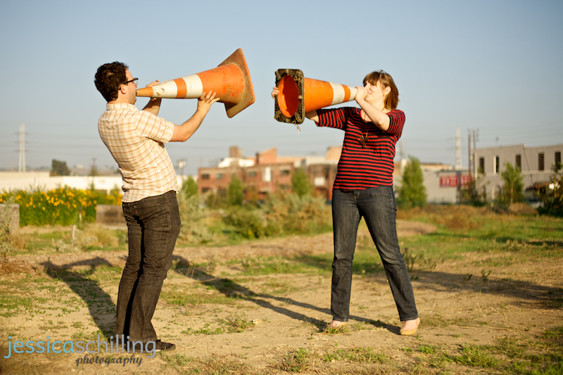 Quirky, funny, cool engagement photos of unique couple shouting through traffic cones