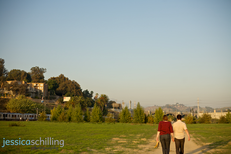 Modern fine art engagement photograph of couple walking barefoot in Los Angeles city landscape