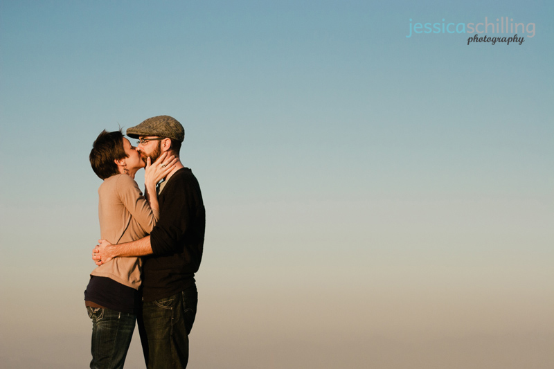 Modern, quirky, indie Los Angeles engagement photography with cute couple kissing in front of sky