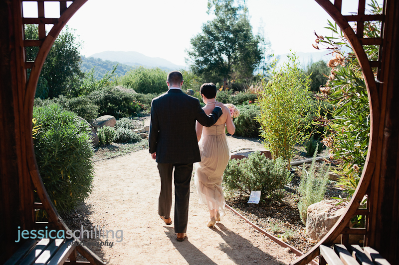 Ojai mountain resort with couple walking down zen garden path