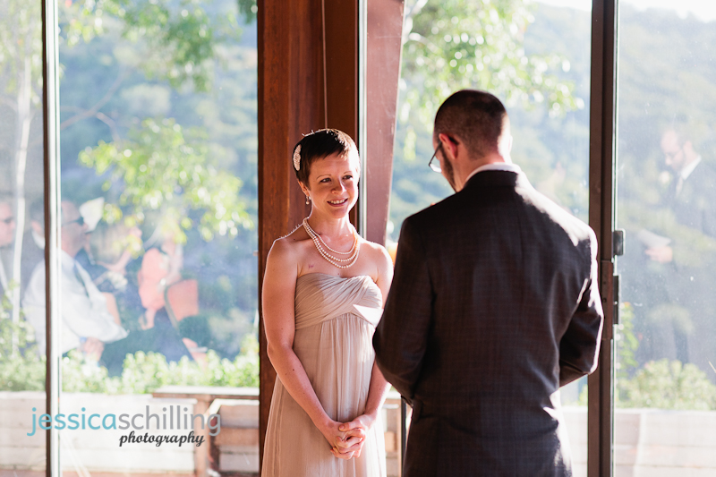 beautiful sunset wedding ceremony with couple reading vows and reflections in windows