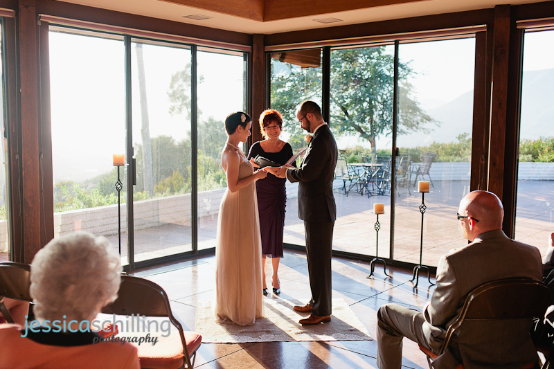 Intimate wedding ceremony couple exchanging rings with Ojai mountains in background