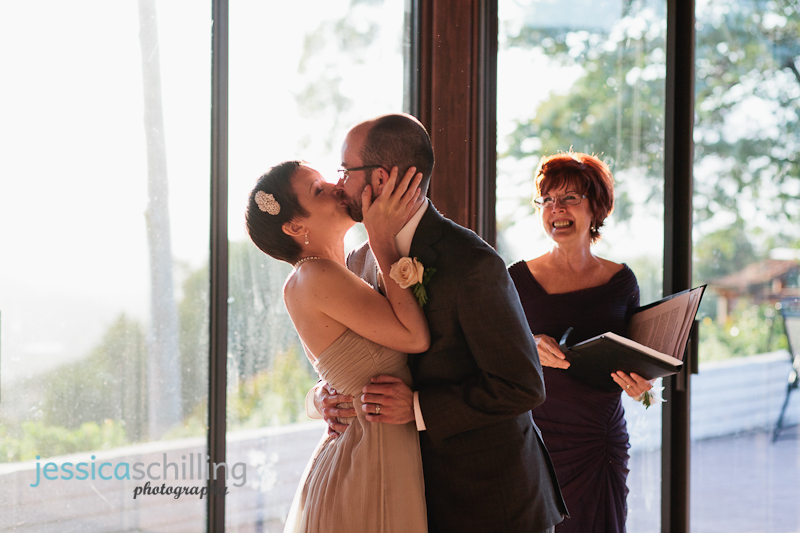 sweet emotional kiss during small intimate Ojai wedding ceremony