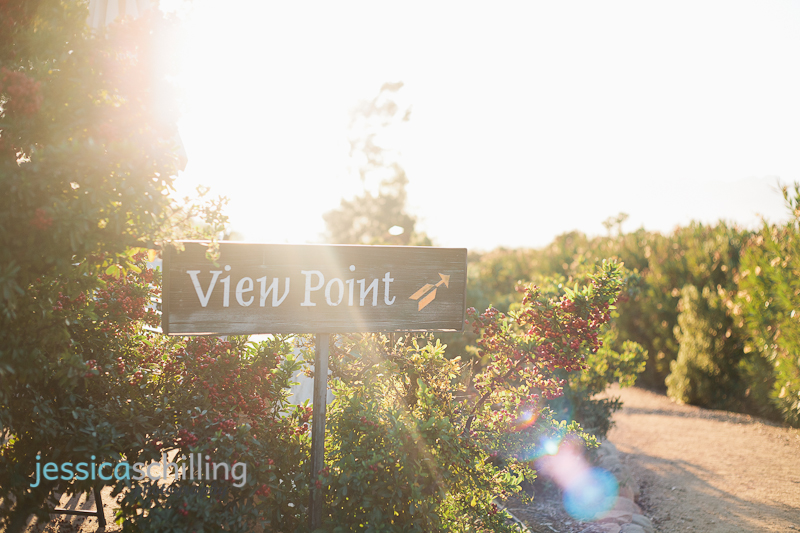 sunset lens flare over sign for scenic view point at Mediation Mount zen garden in Ojai