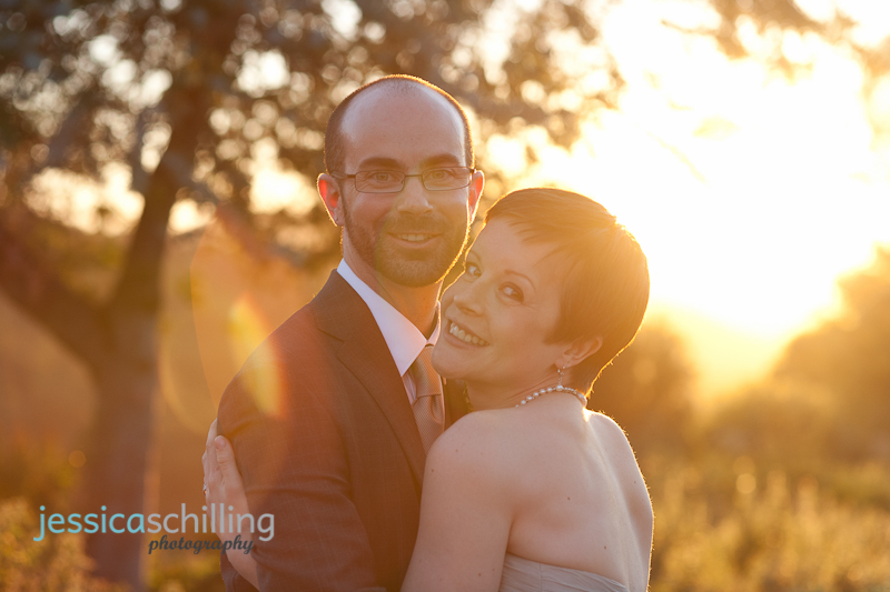 warm sunset light and cool lens flare for wedding bridal portraits by indie wedding photographer Jessica Schilling