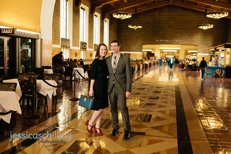 Retro romance with vintage dress and train case in art deco Union Station Los Angeles