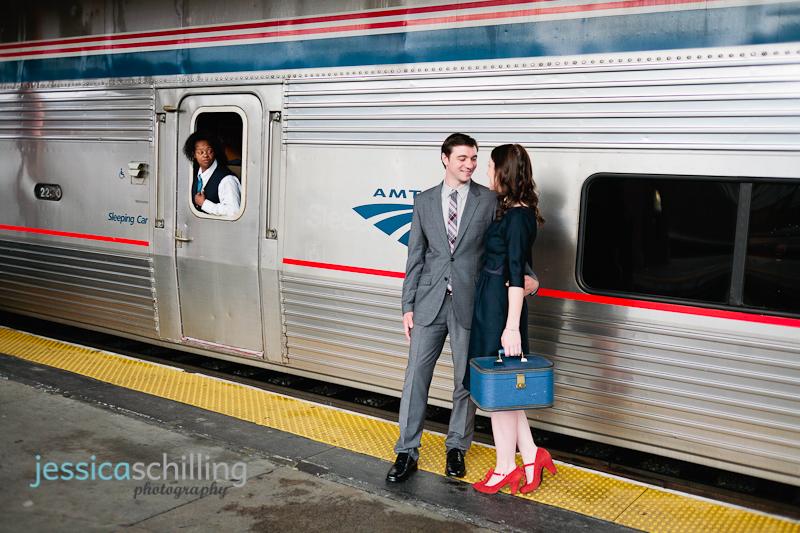 Candid documentary engagement photos of Amtrak employee watching couple on train platform