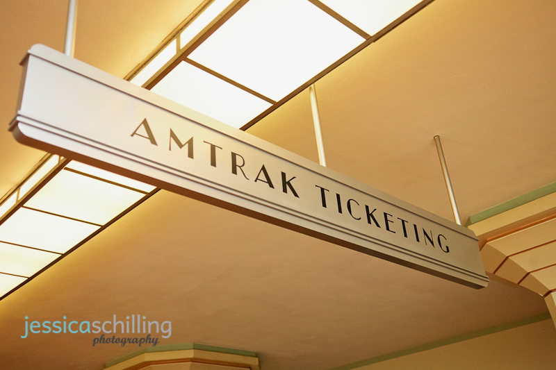 Amtrak train sign and art deco light fixtures in Los Angeles Union Station