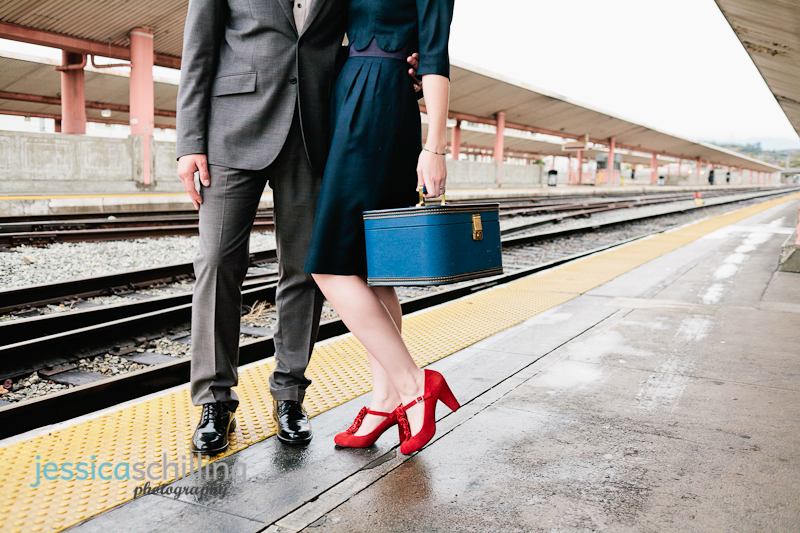 vintage blue train case and red suede heels are the perfect accessories for Union Station engagement photo shoot