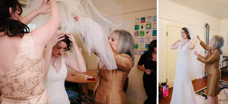 mother of bride helps daughter put on veil at Los Angeles wedding