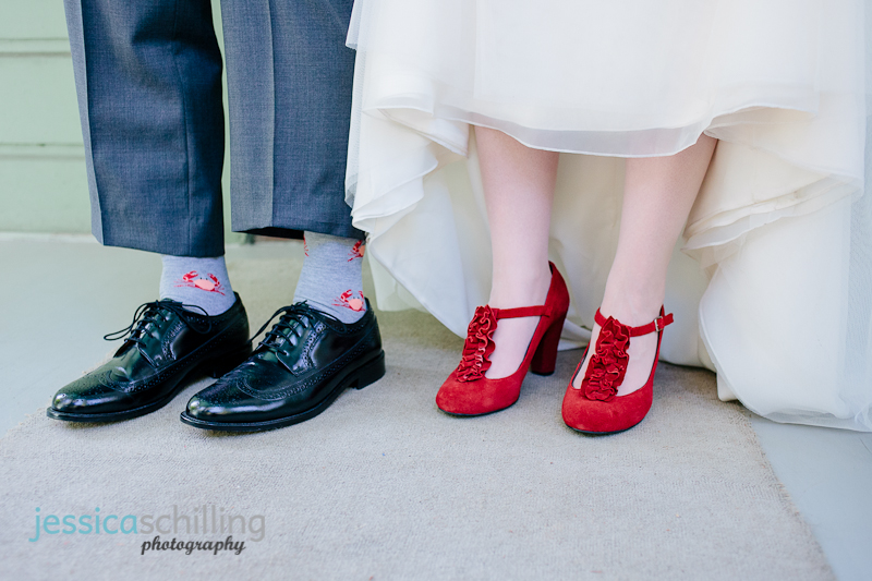 quirky fun novelty socks on groom and sexy red sued shoes for bride