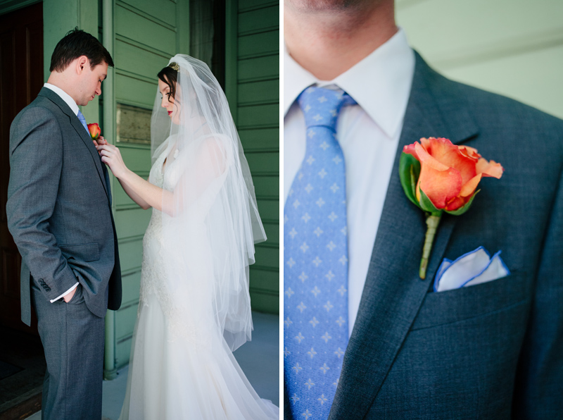 sweet moment of bride pinning orange rose bout on groom