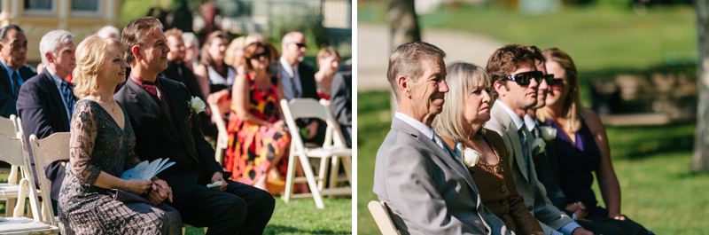 parents lovingly watch bride and groom during wedding ceremony