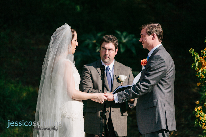 bride and groom exchange rings at outdoor Los Angeles ceremony