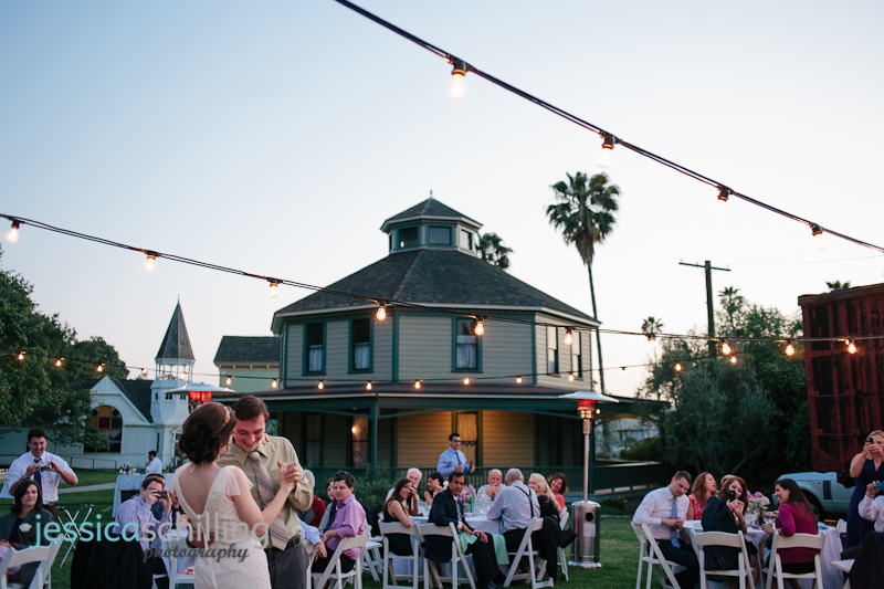 romantic first dance at outdoor reception with string lights