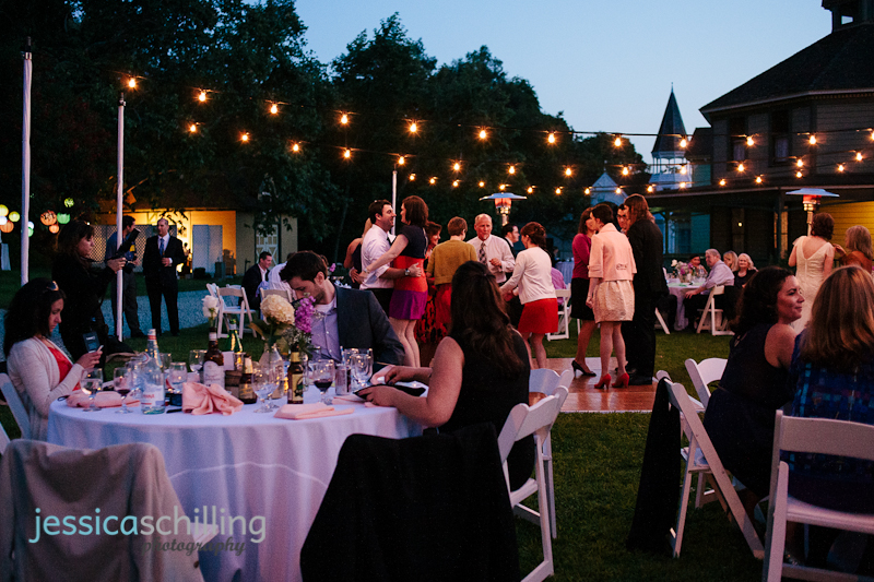 warm, colorful outdoor night reception with glob string lights
