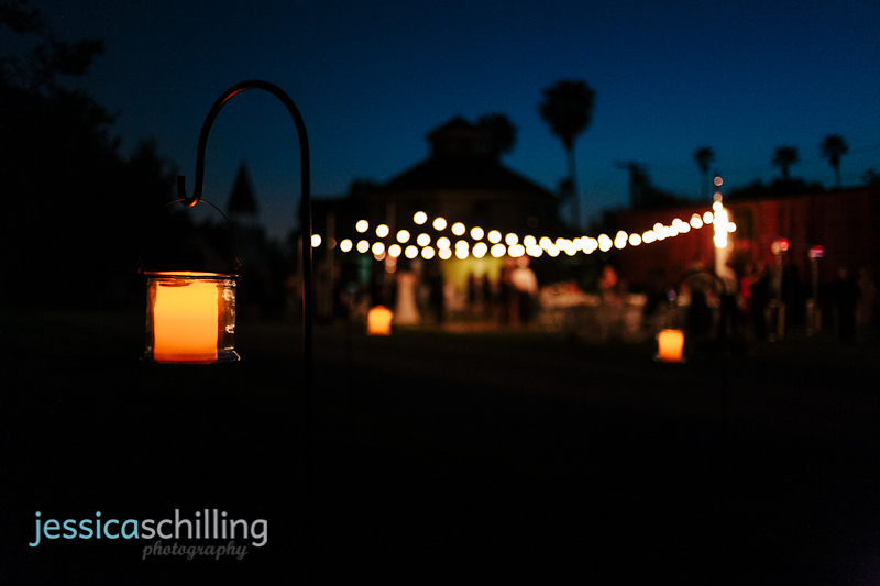candles and string lights for outdoor night wedding reception