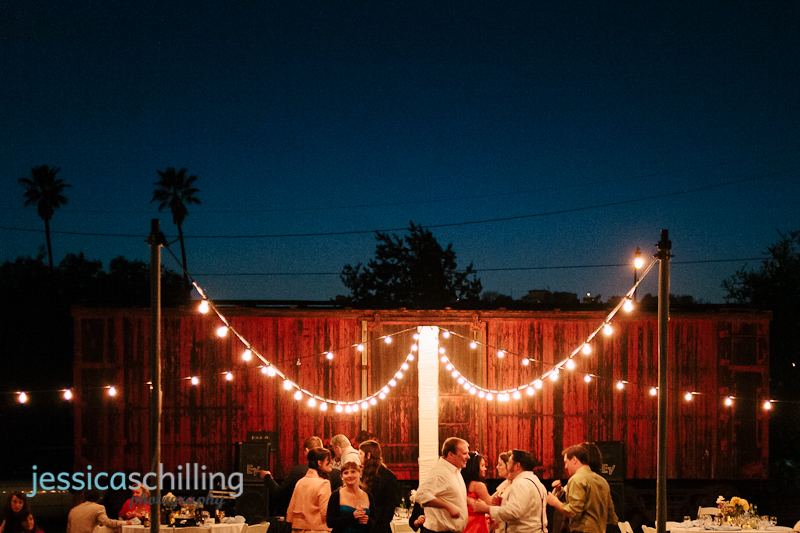 warm beautiful summer night wedding reception lighting