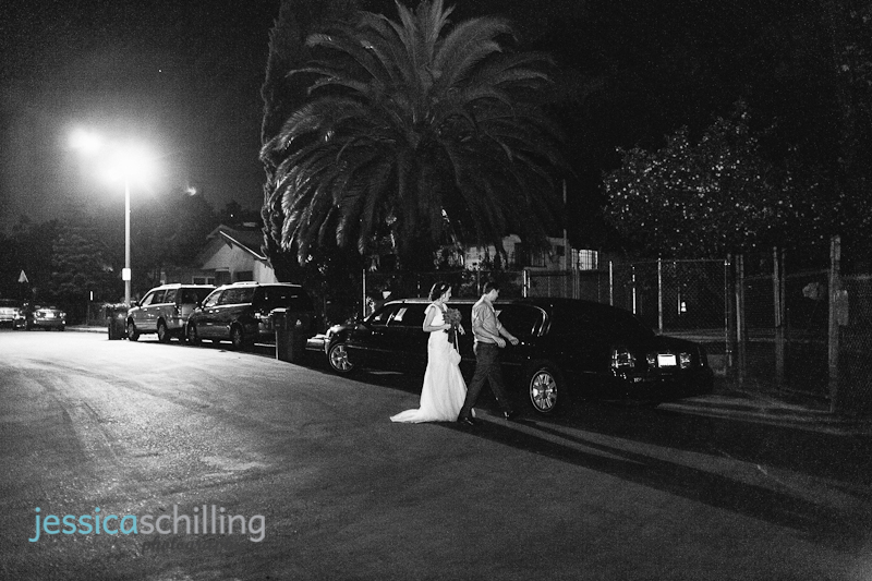 bride and groom get into limo at end of Los Angeles wedding reception