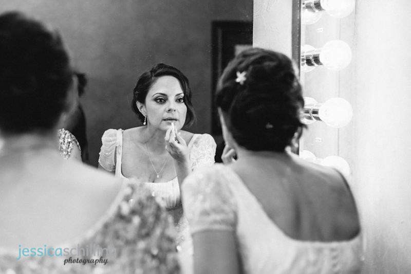 Modern black and white wedding photography bride putting on lipstick