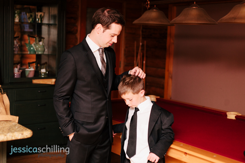 Indie wedding photography of groom and ring bearer getting ready