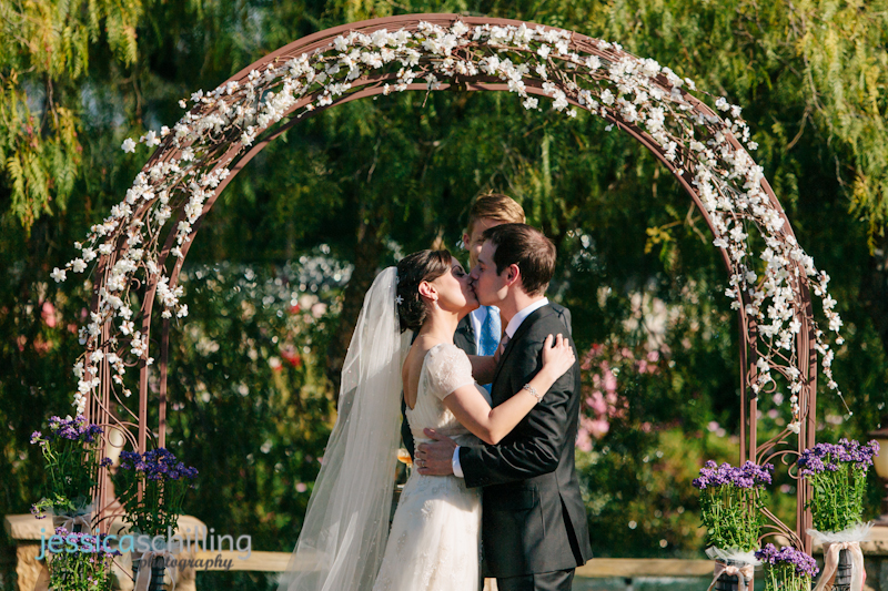 bride and groom kiss during indie modern Persian wedding ceremony Los Angeles