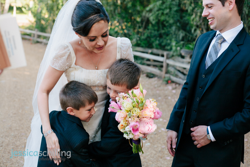bride and groom hug ring bearers after modern Persian wedding ceremony