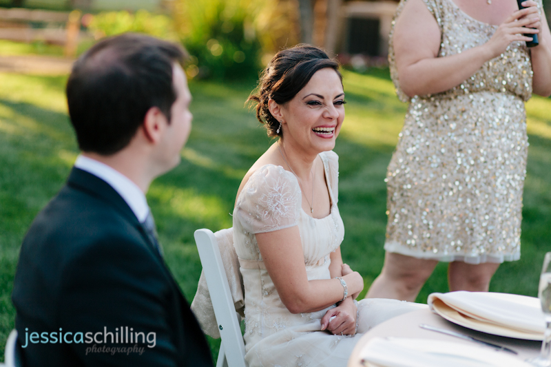 bride laughing at bridesmaid toast during indie wedding reception