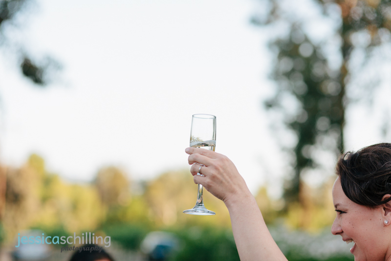 champagne flute toast at outdoor Temecula wedding reception