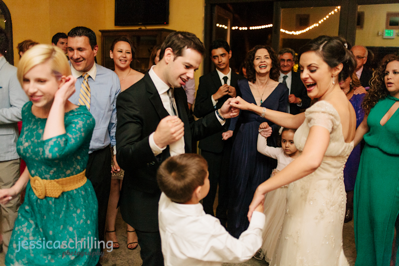 fun, quirky, cool bride and groom dance with kids at indie wedding reception