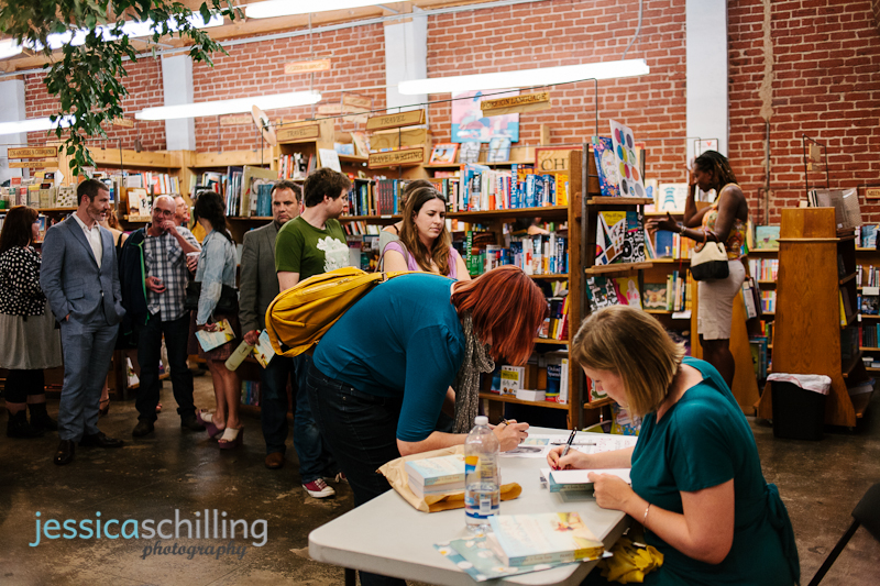 Indie wedding photographer Jessica Schilling getting book signed by author