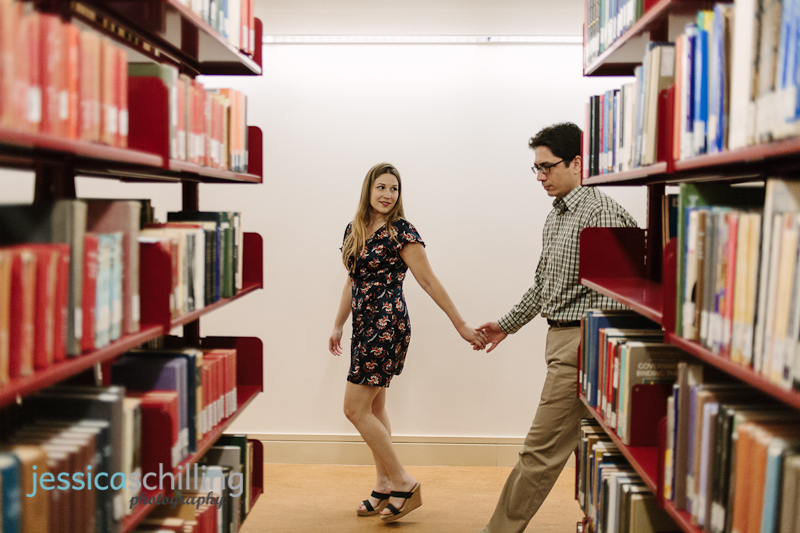 Quirky fun indie engagement photographs in library bookshelves