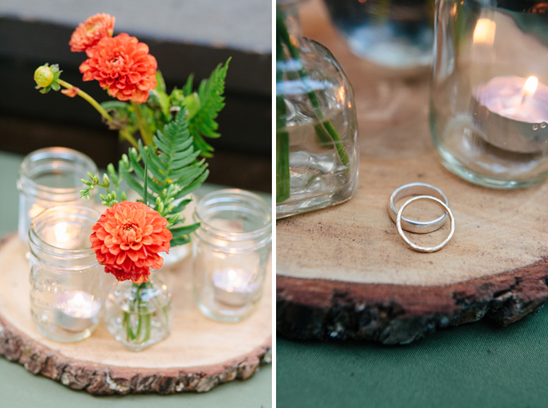 handmade etsy wedding rings and rustic decor of wooden tree rounds and mason jars